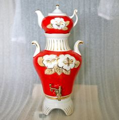 This gorgeous samovar dates back to 1983 and comes from Russia / Soviet Union / USSR.  A samovar (Russian: самовар) is a heated container traditionally used to heat and boil water in and around Russia, as well as in other Central, South-Eastern, Eastern European countries, Kashmir and in the Middle-East. Though traditionally heated with coal or charcoal, many newer samovars use electricity to heat water in a manner similar to an electric water boiler.  This samovar is made of porce...