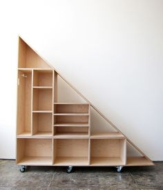 Mobile Triangle Compartment Shelf Must do this for under stairs in living room! Staircase Storage, Stair Storage, Diy Storage, Diy Understairs Storage, Storage Ideas, Staircase Bookshelf, Bookcase, Outdoor Storage, Under Stairs