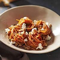 Spaghetti with roasted red peppers, walnuts and goat cheese.