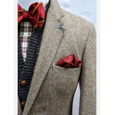 A great way to wear a Bow tie in a less formal style. www.memysuitandtie.com