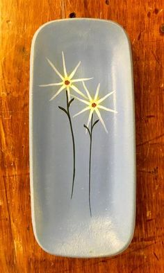 """Hand thrown, painted and glazed by Thomas """"Bud"""" Skupniewitz. There perfect landing spot for jewelry, business cards or even a spoon rest! Food Safe 4"""" wide x 9"""" long"""