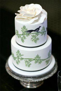 Two-tier banana/caramel and chocolate wedding cake by Faye Cahill Cake design. Photgraphy by SugarLove Weddings.