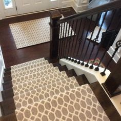 The combination of the hall and stair runners brings continuity throughout each level of this warm and inviting home.