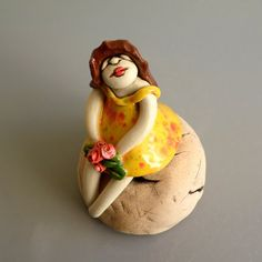 Ceramic sculpture of a young girl  Clay female figure  by ednapio