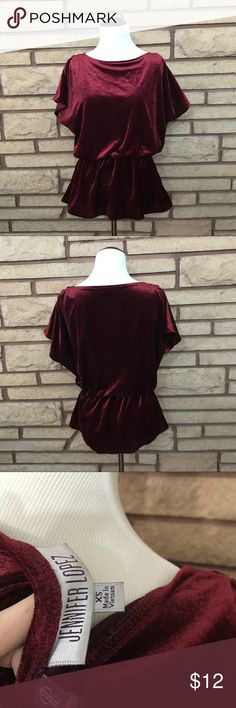 Jennifer Lopez Velvet Peplum Shirt 🌑Beautiful red velvet peplum shirt   🌘In excellent used condition    🌗Material: 100% polyester  🌖Dimensions: 21in bust and 11in waist 🌕Offers Welcome 🌔Fast shipping 🌓Sorry, no trades 🌒Bundle and save 30% off two or more items 🌑Free gift with every purchase Jennifer Lopez Tops