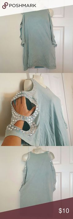 Cutout Sleeve Sparkle Shirt Fun and different shirt for your wardrobe. Is a beautiful light blue color with cutout holes on each sleeves surrounded by crystals. Tops