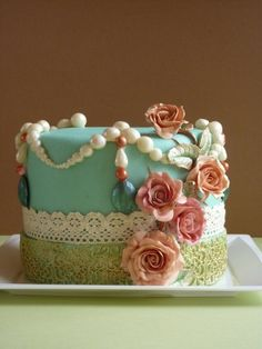 I'm not much for extravagantly decorated cakes, usually, but this one is definitely stunning, and pleasant to look at.    http://myhoneysplace.com/pearls-and-flowers-cake-picture/