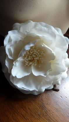 Off White Velvety Cotton Camellia Millinery Flower for Bridal, Hats, Corsages, Floral Supply. $11.95, via Etsy.