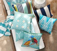 Detailed embroidery adds texture and depth to this pillow's allover interlocking…