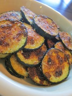 Zucchini Chips - Only 60 Cals. Love making these in the oven on a cookie sheet with olive oil and parmesan cheese!