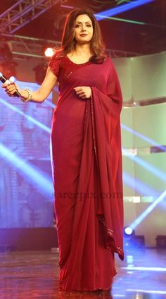 "Sridevi in maroon saree at ""Puli"" audio launch. She was beautiful in transparent saree designed by Manish Malhotra paired with sequin embellished blouse. Trendy Sarees, Stylish Sarees, Dress Indian Style, Indian Dresses, Kerala Saree Blouse Designs, Maroon Saree, Modern Saree, Saree Trends, Saree Look"