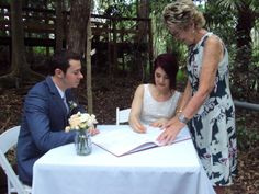Signing the Marriage Register at Walkabout Creek, The Gap, Queensland. A beautiful leafy celebration area and intimate seating . Not a bad seat in the house. #myweddings #bestoutdoorweddings