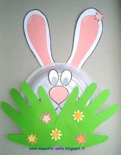 maestra Nella: un coniglio e un pulcino tra l'erba