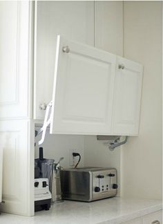I want to show you all the creative hidden kitchen storage solutions I came up w. - I want to show you all the creative hidden kitchen storage solutions I came up with and how they make my life so much easier. I LOVE cooking in my kit. Farmhouse Kitchen Cabinets, Kitchen Redo, Kitchen Microwave Cabinet, Ikea Kitchen Remodel, Kitchen Must Haves, Kitchen Stove Design, Decorating Kitchen Counters, Kitchen Cabinets 2018, Diy Kitchen Makeover