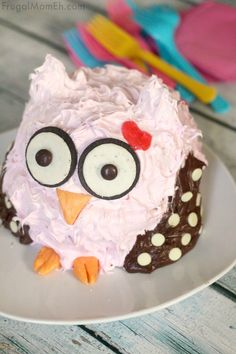 This Owl Smash Cake is an adorable first birthday cake perfect for a 1st birthday party or a cake smash photography session!