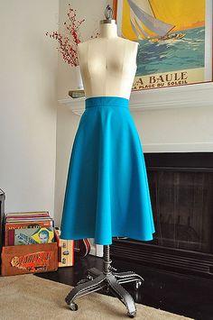 I love the shape and drape of this lovely wool half-circle skirt. via Elegant Musings.