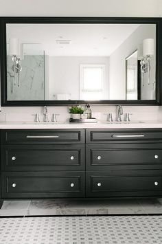 Black dual washstand with stacked drawers displaying glass knobs and horizontal chrome pulls.
