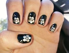 i like this but i would only put the flower on one finger :)