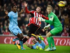 Connor Wickham of Sunderland scores the opening goal during the Barclays Premier League match between Sunderland and Manchester City at The Stadium of Light on December 3, 2014 in Sunderland, England.