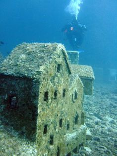 At 30m below sea level, off the Cap d'Antibes, lies the remains of a underwater miniature French town complete with houses and buildings up to 1m high~