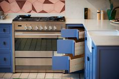 Handles by Armac Martin, Tiles by Marrakech Design, Oven from Fisher & Paykel, Caesarstone Worktop in Noble Grey