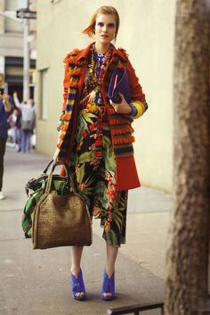 from German Vogue - coat with tufted fringing, layered beads and tropical fabric