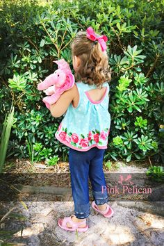 Roses are pink, the fabric is blue. I think the elephant loves her St. Tropez Swing too! Photo by Ashley Worthington. PDF sewing pattern designed by Mummykins and Me. Available for instant download at www.rebecca-page.com. Swing top sewing pattern – This chic Mommy & Me matching set comes in top or dress length. It's got a cute little cut out in the back, optional sleeves and an optional belt