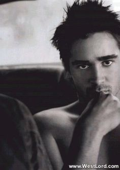 Man: Colin Farrell  Pose: spontaneous  Prop: car, sofa  Gimmick: thumb on lips, chin down, looking out under brow...
