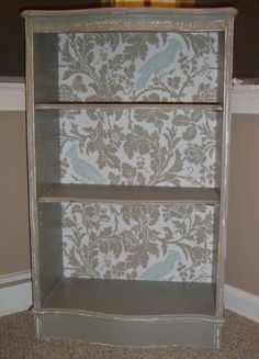 bookshelf with wall paper