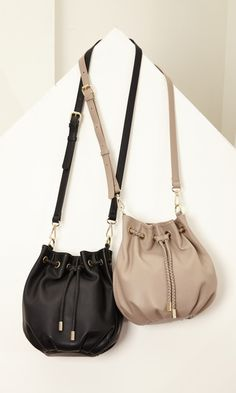 Soft vegan leather mini bucket bag with a drawstring closure, braided detail and removable shoulder strap.