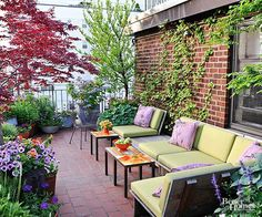 Look to the flowers and plants in your yard for color inspiration. Use the hues you find to accessorize your outdoor spaces. Purple pillows on this patio match the flowers blooming in the nearby containers./