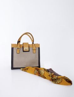 Chest shaped bag decorated with metal elements.