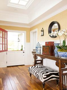 Touches of the exotic rev up this entry, where a Dutch door gives way to a foyer wide enough for a console table stacked with red-lacquer boxes and Chinese vases: http://www.bhg.com/rooms/rooms/entryway/front-entry-decor-ideas/?socsrc=bhgpin032614wildside&page=3