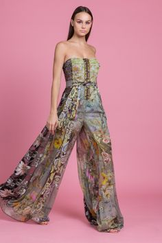 37a8c56943be The Absinthe Jumpsuit is a strapless wide leg jumpsuit with semi sheer  legs. The pant