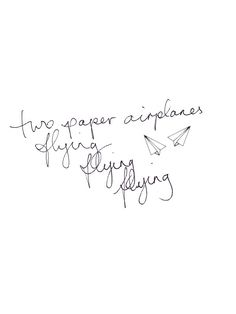 Two papers airplanes flying flying flying.