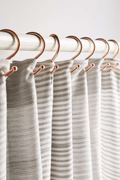 Copper Shower Curtain Hooks. Like these with the colors in the curtain.