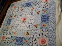 I love this quilt made from vintage chenille pieces!  Got to try making one of these!