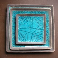 Plat carré de céramique raku turquoise