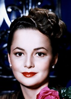 OLIVIA DE HAVILLAND - Olivia Mary de Havilland was born to a British patent attorney and his wife on July 1, 1916, in Tokyo, Japan. After graduating from high school, where she fell prey to the acting bug, Olivia enrolled in Mills College in Oakland. De Havilland won the Academy Award for Best Actress for her performances in To Each His Own (1946) and The Heiress (1949). Today she enjoys a quiet retirement in Paris, France.