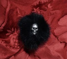 Fashion 925 sterling silver ring with Pompon lapin and skull in the center, on the  ring shinbone and little skulls, limited series to a few specimens, available colors pink or black. Dogale jewellery Venezia Italy