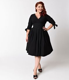 I would wear the shit out of this dress. Unique Vintage Plus Size 1950s Style Black Three-Quarter Sleeve Diana Swing Dress