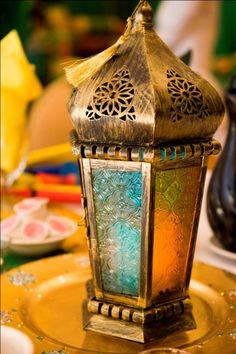 indian-weddings-gold-lamp-decor-mehndi-yellow-orange