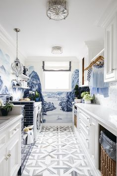 AZURE LANDSCAPES In this space from Dina Bandman Interiors, vivid blue wallcoverings are complemented by natural wood colors and gray patterned floor tiles. White Laundry Rooms, Bathroom Laundry, Laundry Room Design, Bath Design, Mudroom, Room Inspiration, Kitchen Inspiration, Sweet Home, New Homes