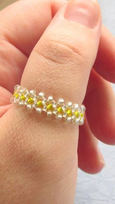 This beaded thumb ring is beadwoven with high quality Japanese yellow and silver seed beads and high quality Japanese beading thread. The beads are uniform in size to prevent any irregularities in the way that it feels on your finger.   $12.75  #thumbring, #beadedring, #bellydancejewelry, #bestiesring, #bridalaccessory