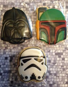 Star Wars Darth Vader, Storm Trooper, Boba Fett decorated royal icing sugar cookies, by Kids to College Cookie Creations. www.facebook.com/kidstocollegecookiecreations