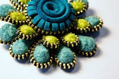 Felted crochet petals wrapped in brass zipper | I've been co… | Flickr