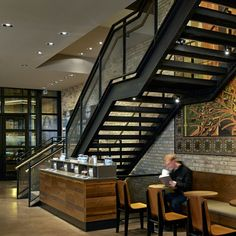 The staircase for Starbucks at Oak and Rush in Chicago features Banker Wire M22-22 woven wire mesh.