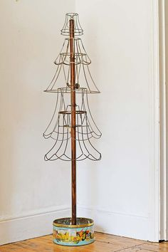 How To Make A Rustic Christmas Tree From Old Lampshades Industrial upcycled wire rustic Christmas tr Noel Christmas, Rustic Christmas, All Things Christmas, Winter Christmas, Christmas Ornaments, Vintage Christmas Trees, Industrial Christmas Trees, Christmas Lights, Recycled Christmas Tree