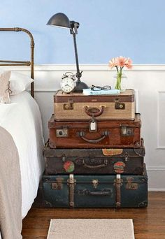 <3 vintage suitcase nightstand ~ this is awesome! Perfect for our travel room as an accent table or in a guest bedroom for a nightstand. I see vintage suitcases at yard sales and thrift stores all the time!
