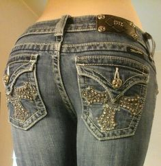 Starting at $24.99, a pair of women's Miss Me Gothic Glam Bling RS Crystal Cross Tri Flap Pkt Distressed Jeans 27 #MissMe #BootCut